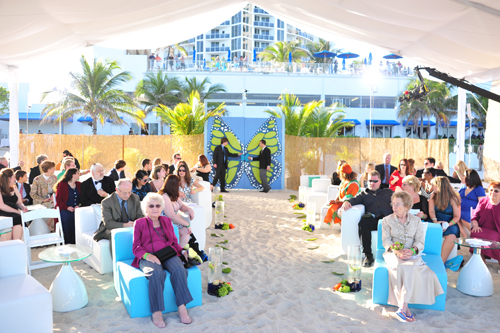 Beach wedding ceremony tent, butterfly gate, turquoise and white couches. Miami Beach