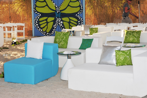 turquoise, green, and white couches on sand. Wedding in Miami Beach. Butterfly gate.