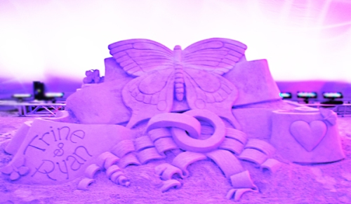 butterfly sand castle. purple, rings, wedding reception in Miami Beach.