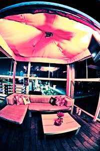 Party cabana at lounge decorated with personalized throw pillows for Miami wedding reception