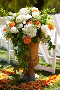 Hydrangeas, roses, and ivy in urn for wedding ceremony