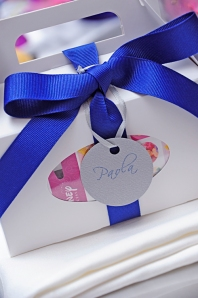 Kids gift box with cobalt blue grograin ribbon and round silver label.